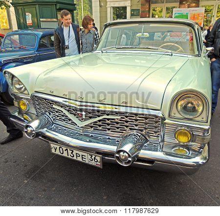 Townspeople Around Soviet Luxury Car Of 1960-70S Gaz M13 Chaika