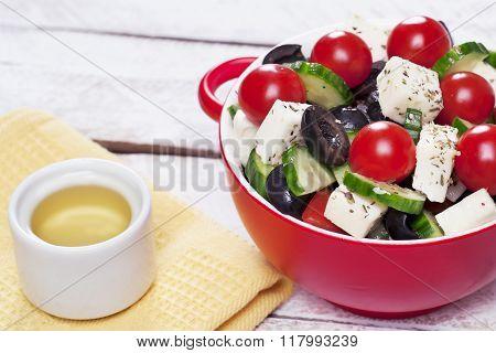Greek salad in red boul