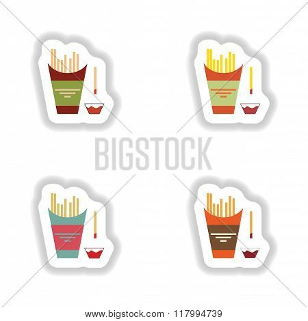 assembly paper stickers on white fries and ketchup
