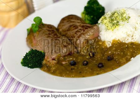 Beef Roulade with Broccoli , Rice and Sauce