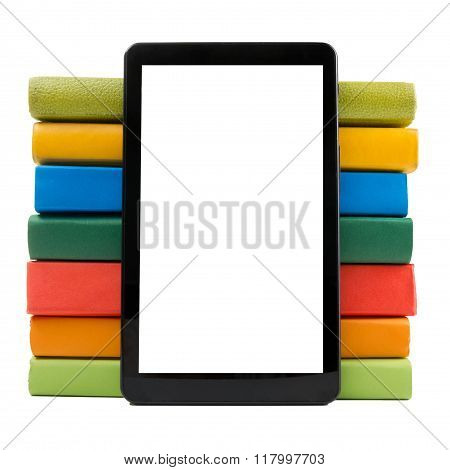 Stack of colorful books and electronic book reader. Electronic library concept. Back to school. Copy