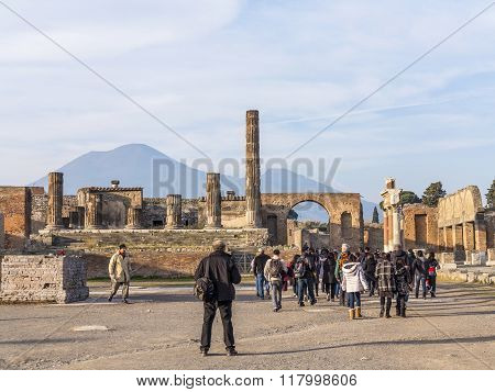 People Are Walking Through Ruins Of The Historical City Of Pompeii