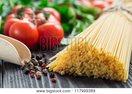 Italian Spaghetti On A Wooden Table.