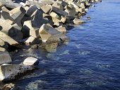 image of rip-rap  - concrete blocks used in construction of breakwater - JPG