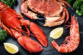 Постер, плакат: Fine Selection Of Crustacean For Dinner Lobster Crab And Jumbo Shrimp