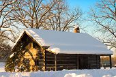 pic of olden days  - white snow covered cabin in canada in the winter - JPG