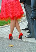 stock photo of upskirt  - Foots of men and women on background paving slabs in park - JPG