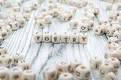 Poetry word written on wood block. wooden abc. poster