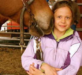image of horse girl  - girl enjoying the affectionate nuzzle of her favorite horse  - JPG