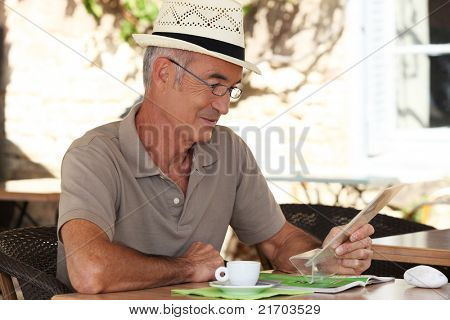 Man sitting at an outdoor cafe table