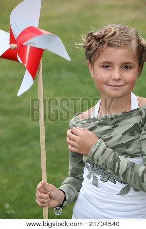 little girl and a paper windmill
