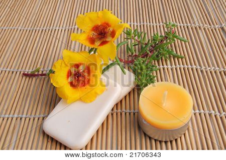 candle and soap on bamboo background