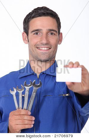 a 35 years old mechanic is showing a business card