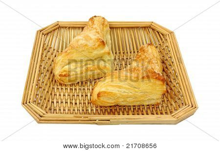 Two Apple Turnovers In Wood Basket