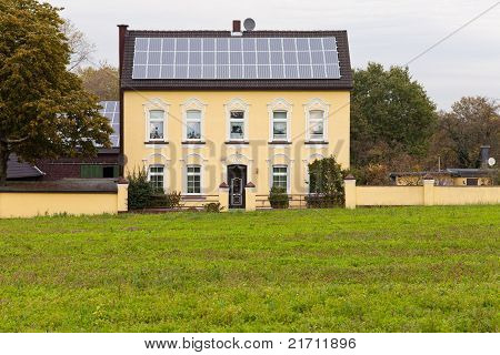 Historic house with solar panels on roof