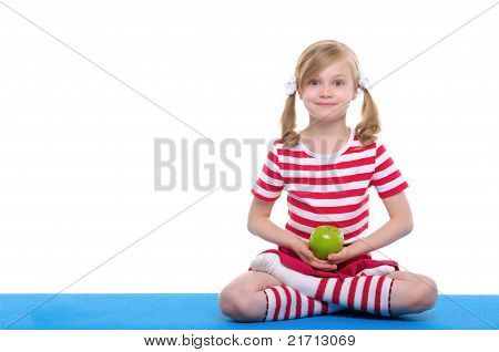 girl with open eyes practice yoga and keep apple