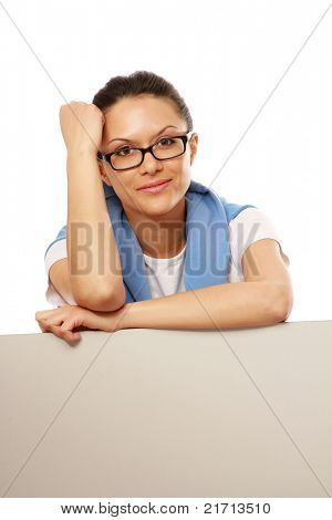 A smiling woman with a blank behind isolated on white