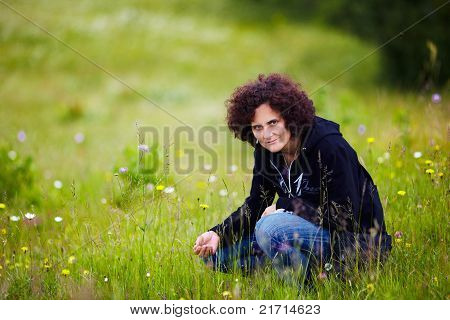 Young Woman Outdoor On Grass