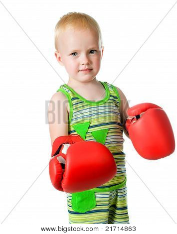 little boy in red boxing gloves