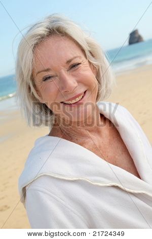 Portrait of happy senior woman in spa resort