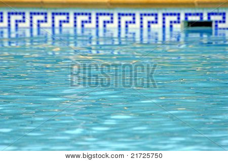 blue water of the pool and mosaic border