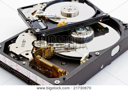 Detail Comparison Of  An Open 2.5 And 3.5 Disk Drive