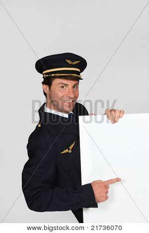 Man dressed up as an airline captain with a board left blank for your message