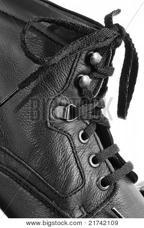 closeup of a casual black leatherette boot