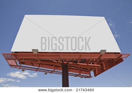 Giant blank billboard with a bright blue sky.