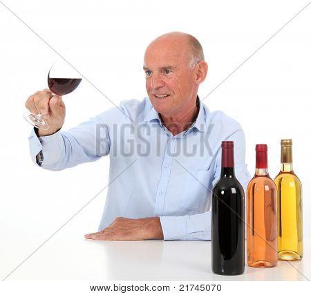 Portrait of winemaker tasting wine