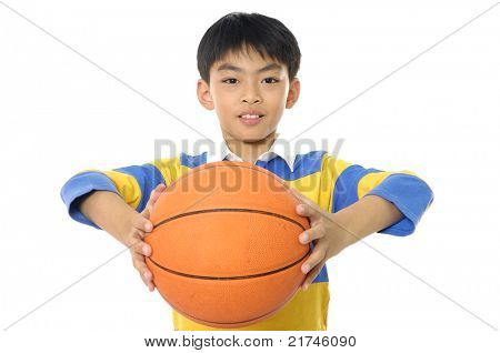 A young boy holding a Basketball-close up