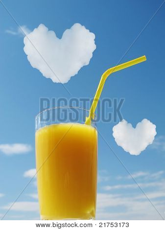 Orange juice in glass. Hearts in a sky
