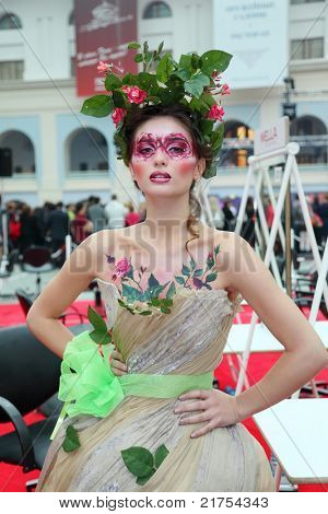 MOSCOW - OCTOBER 2: Beautiful young model with bodyart