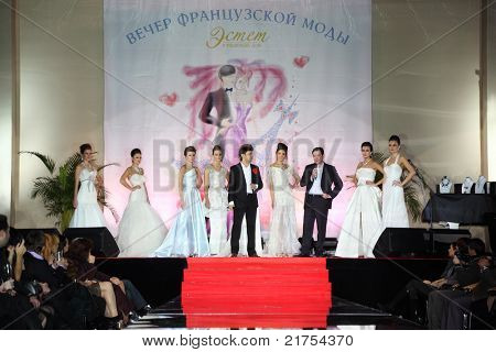 MOSCOW - FEBRUARY 14: Models wear wedding dress standing on stage at evening of French fashion in jewelry salon Estet, on February 14, 2011 in Moscow, Russia. Jewelry House Estet was founded in 1991.