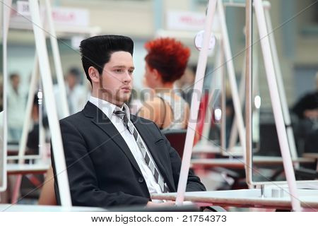 MOSCOW - OCTOBER 2: Man with beautiful hairstyle at XVII International Festival