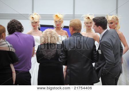 MOSCOW - OCTOBER 2: Four models with fanciful hairdo and photographers at XVII International Festival