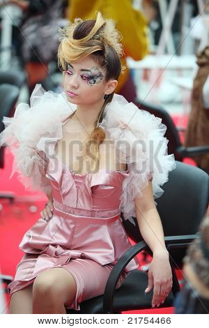 MOSCOW - OCTOBER 2: Model with unusual hairstyle and make-up wear dress at XVII International Festival