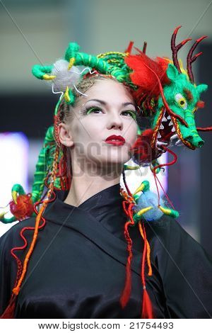 MOSCOW - OCTOBER 2: Model with fanciful braiding hairdo