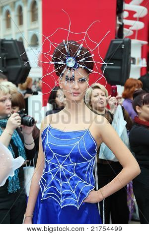 MOSCOW - OCTOBER 2: Model with hairstyle in form of web with spider at XVII International Festival