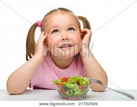Cute Little Girl Eats Vegetable Salad