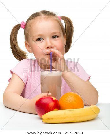 Little Girl Drinks Fruit Juice