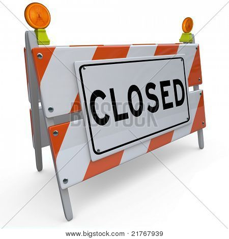 A construction barricade with the word Closed, signifying that a road or street is closed off for access due to work being done, or website or other business is down for repairs or rebuilding