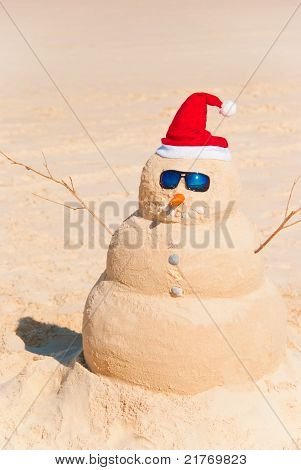 Snowman Built As Sandcastle On Beach