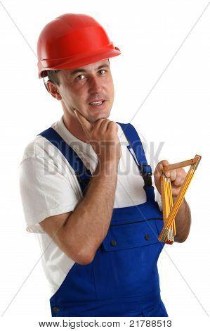Craftsmen With Safety Helmet Holding A Ruler