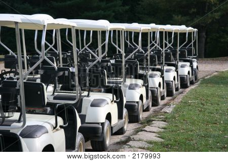 Golf Carts In A Row At A Golf Course