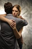 image of atonement  - Couple in an embrace on an gray background - JPG