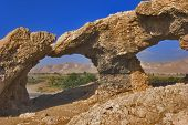 Natural Arches In Ancient Mountains. poster