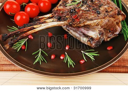 served charbroiled ribs on plate over wood