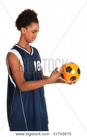 Black basketball player with soccer ball