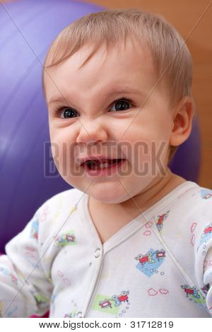 Portrait of evil smiling baby girl